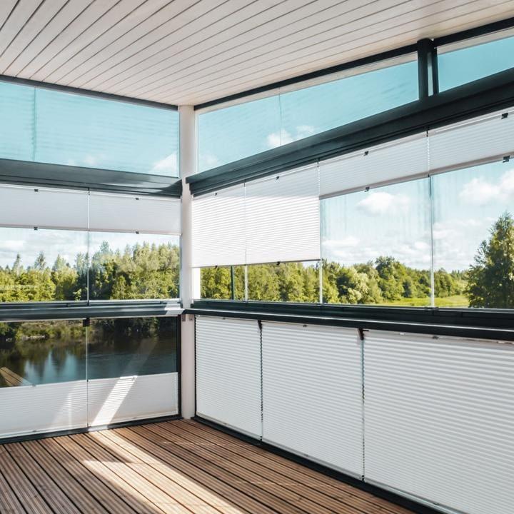 Solskjerming glassrekkverk